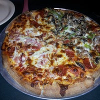 Photo taken at Star Pizza by Julie M. on 3/22/2013