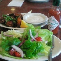 Photo taken at Amici's East Coast Pizzeria by Stella B. on 7/25/2013