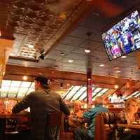 Photo taken at Red Robin Gourmet Burgers by Bryan J. on 10/14/2012