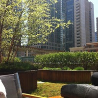 Photo taken at One Superior Place Pool Deck (One W Superior) by Courtney C. on 5/15/2013