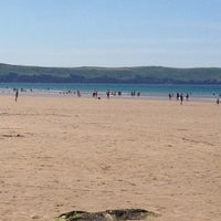 Photo taken at Woolacombe Beach by David on 7/10/2013