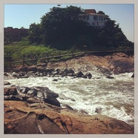 Photo taken at Praia do Sonho by Aline F. on 5/4/2013