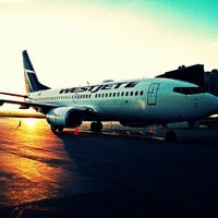 Photo taken at Calgary International Airport (YYC) by Harrison B. on 7/27/2013