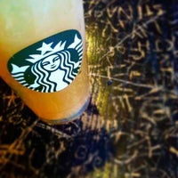 Photo taken at Starbucks by Christina on 6/27/2014