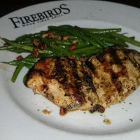 Photo taken at Firebirds Wood Fired Grill by Drew T. on 2/11/2012