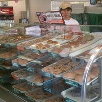 Photo taken at Krispy Kreme Doughnuts by Chris on 9/18/2011