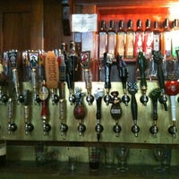 Photo taken at Rogue Ales Public House & Distillery by Laura D. on 6/20/2011