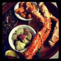 Photo taken at Rustic Inn Seafood Crabhouse by Alex M. on 2/27/2012