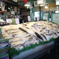 Photo taken at Pike Place Fish Market by Stephanie S. on 7/25/2012