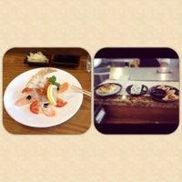 Photo taken at SushiStop by Uthai on 7/2/2012