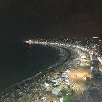 Photo taken at Praia da Costa by Silvana e Floriano Schwanz B. on 1/2/2013