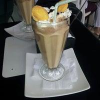 Photo taken at Cafe De La Avenida by Carolina R. on 1/15/2013