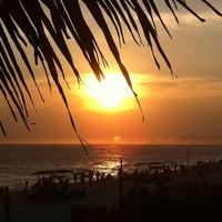 Photo taken at Praia da Barra da Tijuca by Denise on 1/1/2013