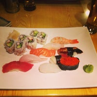 Photo taken at Murasaki Restaurant and Sushi Bar by Forrest K. on 12/24/2012
