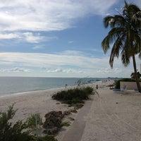 Photo taken at Bonita Beach by RumShopRyan on 7/11/2013