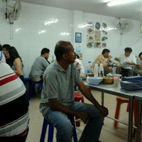 Photo taken at ร้านข้าวต้มแฝด by Noodang N. on 4/1/2012
