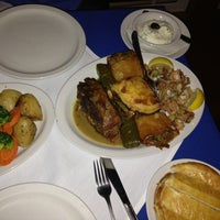 Photo taken at Asteras Greek Taverna by Marie A. on 12/21/2012