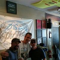 Photo taken at Elk Head Tap Room by Dylan W. on 7/25/2015