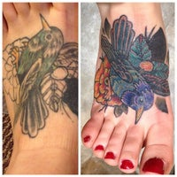 Photo taken at NoKaOi Tiki Tattoo and Piercing by Allie I. on 2/16/2014
