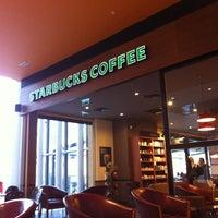 Photo taken at Starbucks by Ozcn A. on 10/12/2012