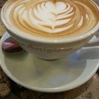Photo taken at Caffè Artigiano by Adrian B. on 2/23/2013