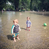 Photo taken at Volunteer Park Wading Pool by Kamel P. on 7/4/2014