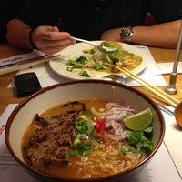 Photo taken at Wagamama by Eri T on 12/13/2012