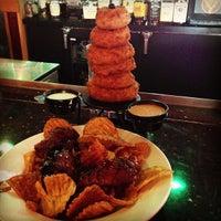 Photo taken at Red Robin Gourmet Burgers by TamKatt on 7/26/2013