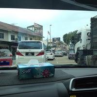 Photo taken at Simpang Empat Semabok by Hafiz H. on 2/6/2016