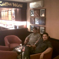Photo taken at Coffee World by DODI B. on 12/21/2012
