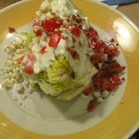 Photo taken at Ninety Nine Restaurant by Nelly R. on 3/9/2013