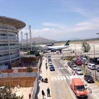 Photo taken at Aeropuerto Internacional Comodoro Arturo Merino Benítez (SCL) by Roberto A. on 11/24/2013