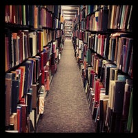 Photo taken at Mugar Library by Selin D. on 12/13/2012