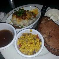 Photo taken at Smokey Bones Bar & Fire Grill by Teresa O. on 11/16/2013