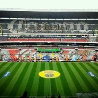 Photo taken at Estadio Azteca by Raúl V. on 5/18/2013