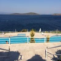 Photo taken at Kırmızı Değirmen Beach by Alper Ş. on 8/26/2015