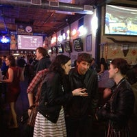 Photo taken at Bikinis Sports Bar & Grill by Bastian B. on 3/10/2013