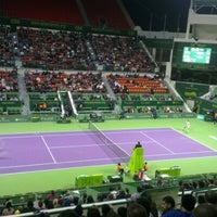 Photo taken at Khalifa International Tennis & Squash Complex by Chirawan P. on 1/3/2013