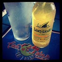 Photo taken at Fish Tales Lakeside Grille by Ashley H. on 5/8/2013