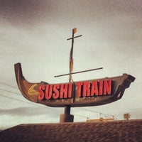 Photo taken at Sushi Train by Jim E. on 12/29/2012