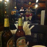 Photo taken at Smile Boat Beer Garden Pub & Restaurant by Mouk on 12/3/2012
