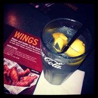 Photo taken at Smokey Bones Bar & Fire Grill by Djenny F. on 6/21/2013