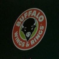 Photo taken at Buffalo Wings & Rings by Lesley P. on 1/25/2013