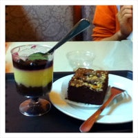 Photo taken at Library Café by Maakul 🐢 J. on 12/13/2012