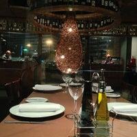 Photo taken at Restaurant Tierra de Fuego by Carlos V. on 6/8/2013