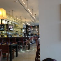 Photo taken at Wolfgang Puck Bar & Grill by Michael R. on 11/23/2012