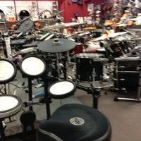 Photo taken at Guitar Center by Race on 3/21/2013