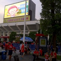 Photo taken at Tianhe Sports Center by Kelvin L. on 8/25/2013