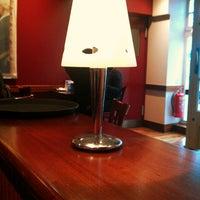 Photo taken at Caffè Nero by Tunc E. on 3/8/2013