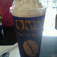 Photo taken at Coffee World by Numnim C. on 10/7/2012